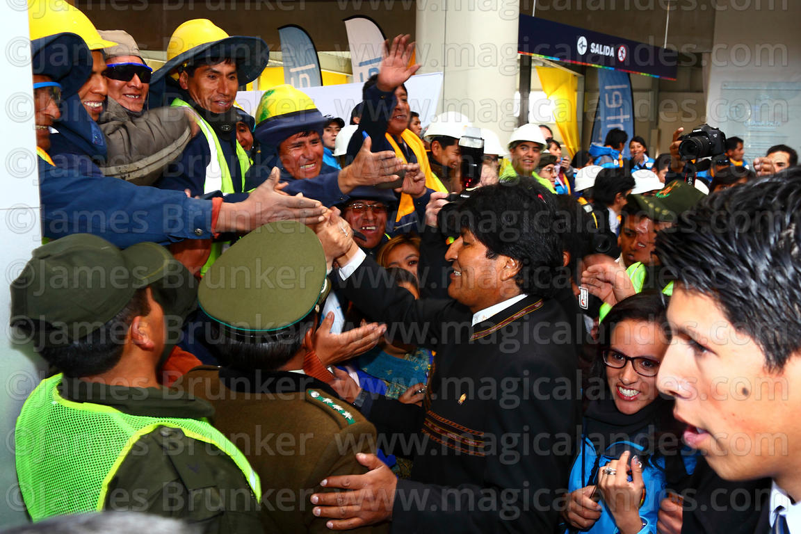 President Evo Morales (centre) greets Mi Teleferico company workers as he arrives for the opening ceremony of the Yellow Line...