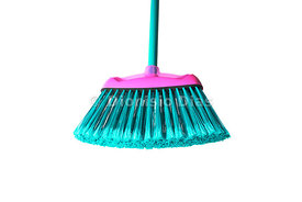 Broom in greenish blue color with detail on the bristles, white background isolated