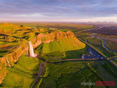 Aerial drone image of Seljalandsfoss waterfall at sunset, Iceland