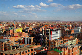View over brick buildings, part of airport in distance, El Alto, Bolivia