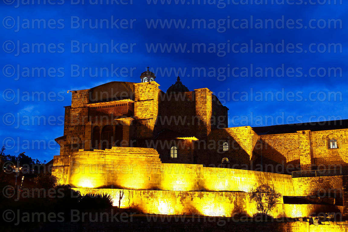 Santo Domingo church and Inca wall of the Coricancha / Sun Temple lit up at twilight, Cusco, Peru
