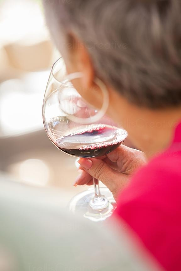 Baby boomer drinking red wine