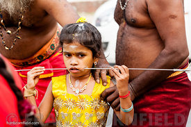 Young girl taking part in Thaipusam festival.