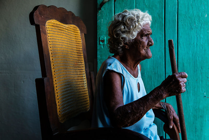 Old Woman Sitting in her Rocker in Doorway
