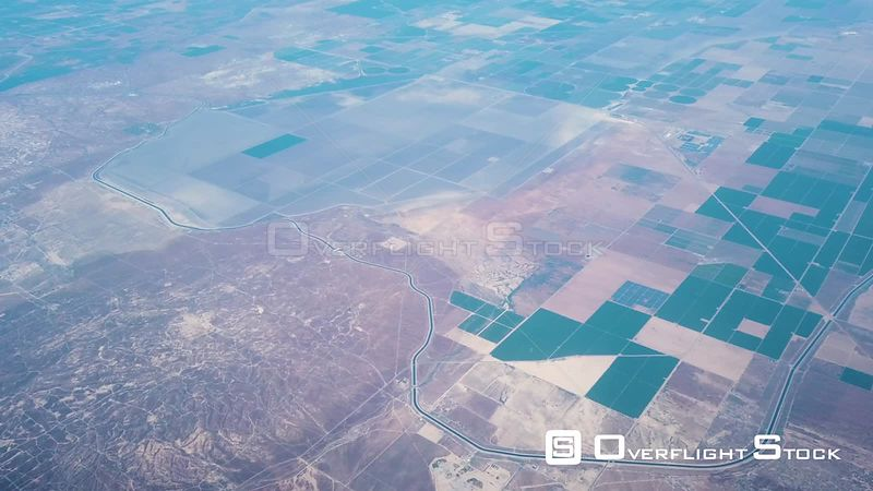 Aerial View Of California Aquduct Passing By Oil Fields And Agricultural Lands In California's Central Valley