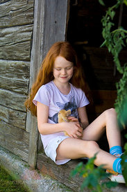 Germany, Salzburger Land, Girl (8-9) holding rabbit
