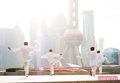Chinese men practicing Tai Chi on the Bund, Shanghai, China
