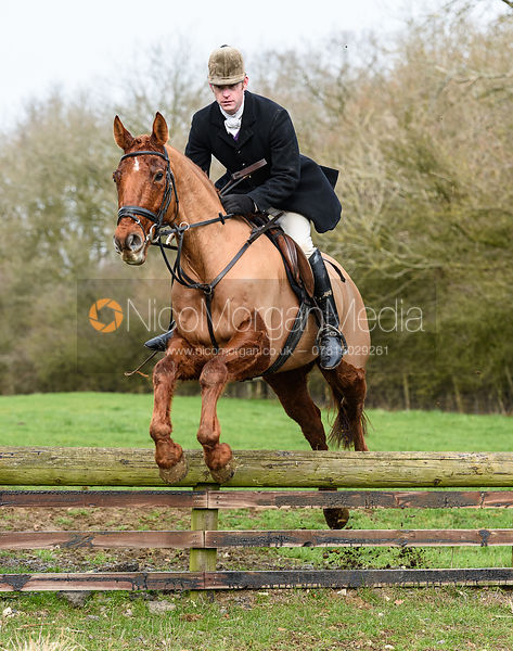 Angus Smales jumping a hunt jump at Cold Overton Wood. The Cottesmore Hunt at The Priory