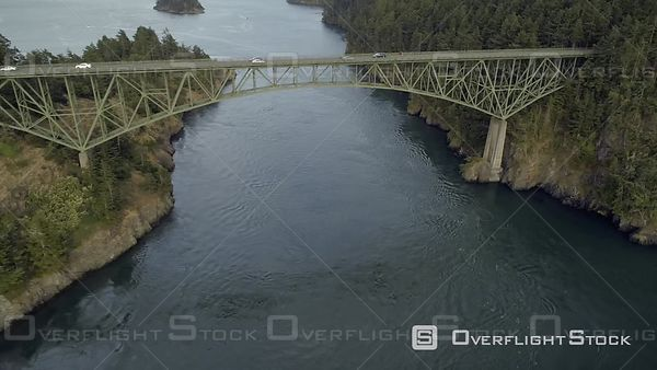 Classic film stock aerial shot of Washington State landmark Deception Pass bridge over Puget Sound