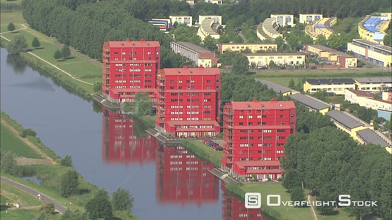 Flying over red apartment buildings along a canal in Almere, The Netherlands