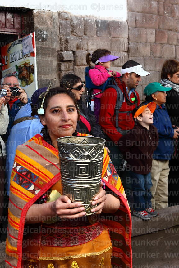 Ñusta / Virgin of the Sun holding a golden ceremonial cup called a kero during processions for Inti Raymi festival , Cusco , ...
