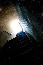 An atmospheric image of some steps up to the light.