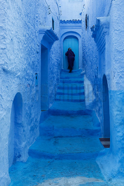 Narrow Alley Leading to a Home in the Blue City