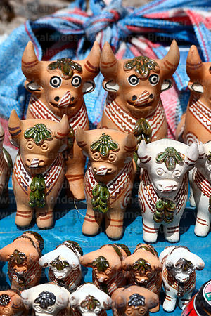 Stall selling painted ceramic bulls in Chinchero market, Sacred Valley, Peru