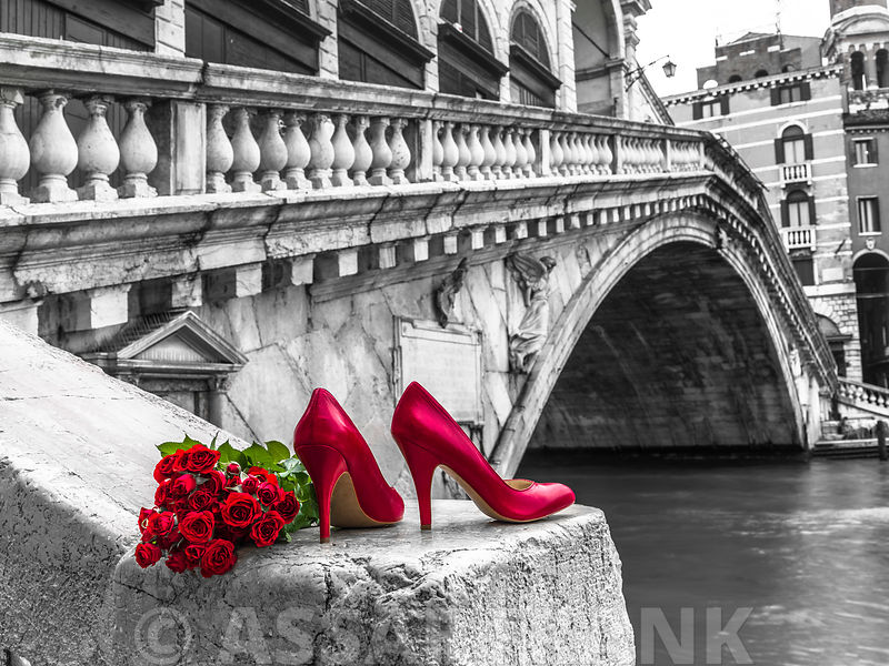Bunch of red roses and red high heel shoes, Rialto Bridge, Venice, Italy