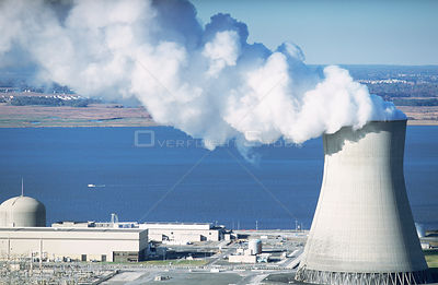 Aerial view of Salem nuclear power plant cooling tower at edge of saltmarshes, Delaware Bay, New Jersey, USA