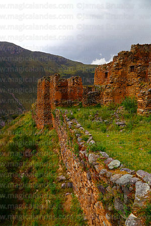 Ruined buildings and part of defensive wall in Inca site of Pumamarca, Patacancha Valley, Cusco Region, Peru