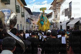 Musicians following figure of Virgen de Belen through streets during Corpus Christi festival , Cusco , Peru