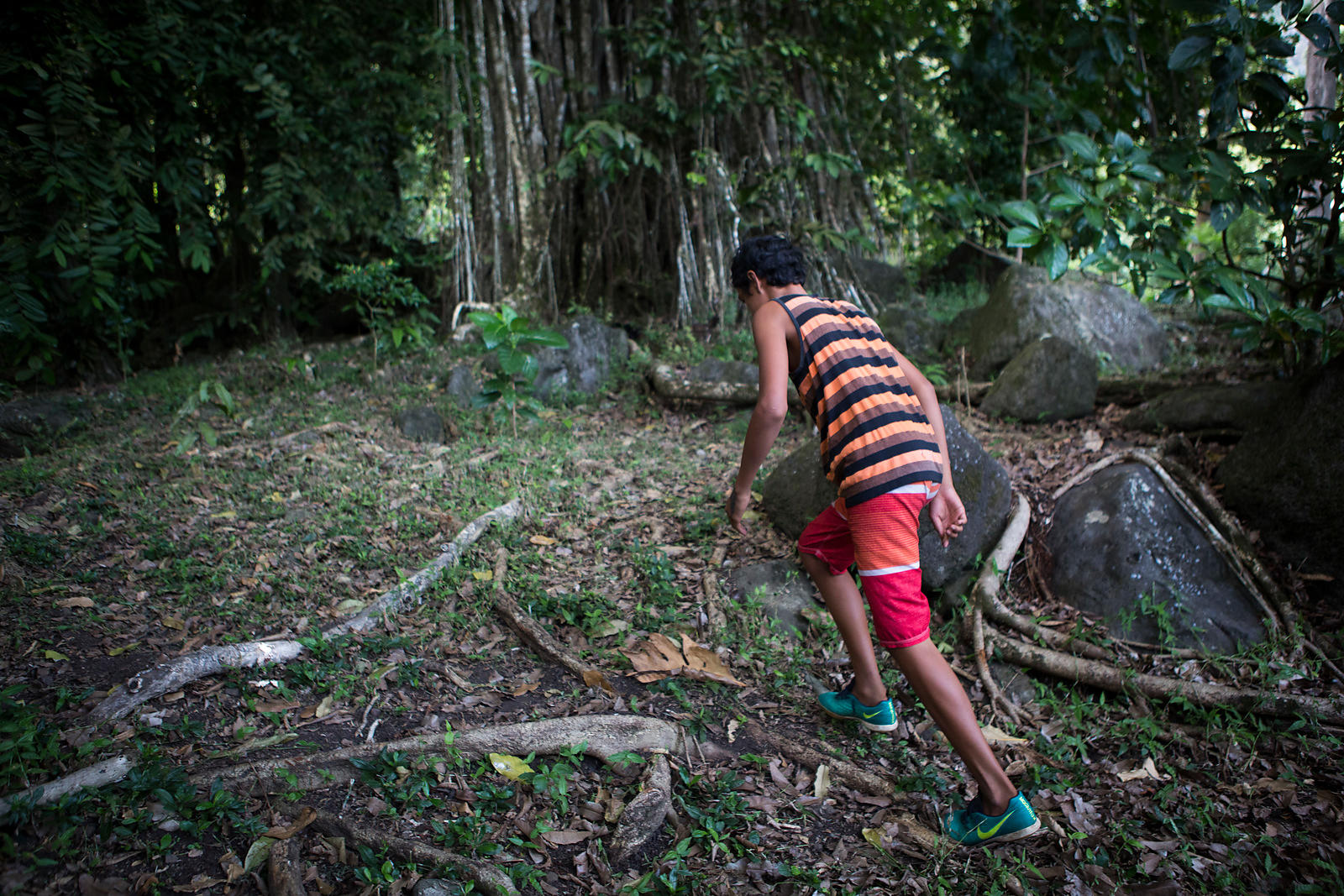 Benjamin, 14, studies the wood carving at the Center for Young Adolescents (CJA) of Atuona, Hiva Oa Island, Marquesas Islands...