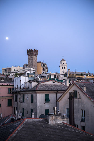 A Moon Over The Skyline In Genoa