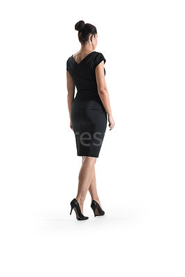 A woman, in a black dress, walking away – shot from low level.