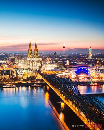 Bridge and city skyline at night, Cologne, Germany