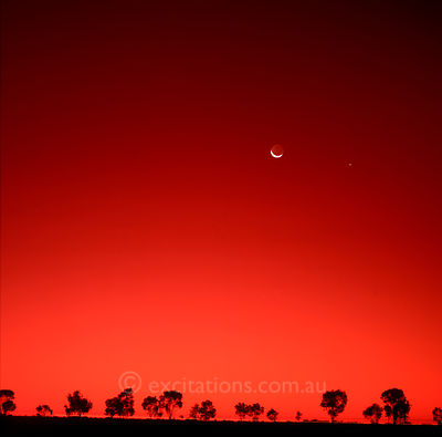 Moon and Venus in Red Australian sky.