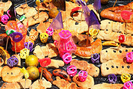Detail of bread and fruit offerings and sugar ornaments on tomb, Todos Santos festival, La Paz, Bolivia