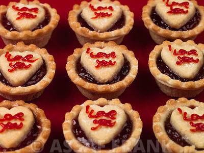 Jam tarts on red background