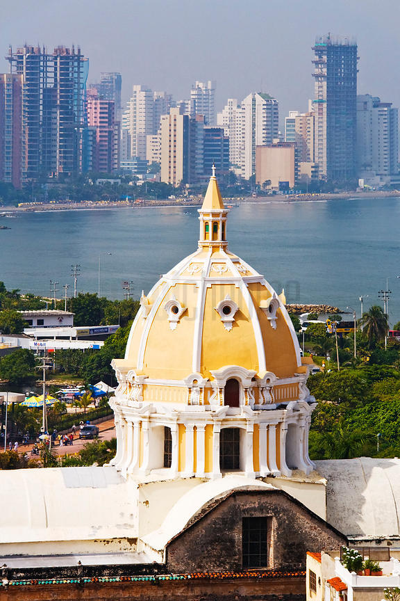 Dome of Iglesia de San Pedro Claver with High Rises of Bocagrande Behind Cartagena