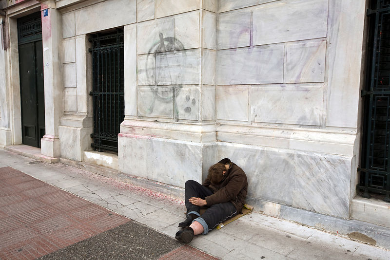 Greece - Athens - A homeless man asleep whilst begging near Syntagma Square