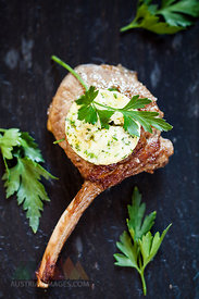 Slice of compound butter on lamb chop