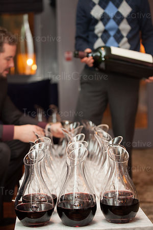 Red wine being decanted for a tasting