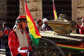 A member of Los Colorados presidential regiment with caskets with remains of members of the Junta Tuitiva as they are taken f...