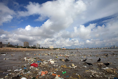 Trash on Chowpatty beach, the most popular public beach in Mumbai, India.