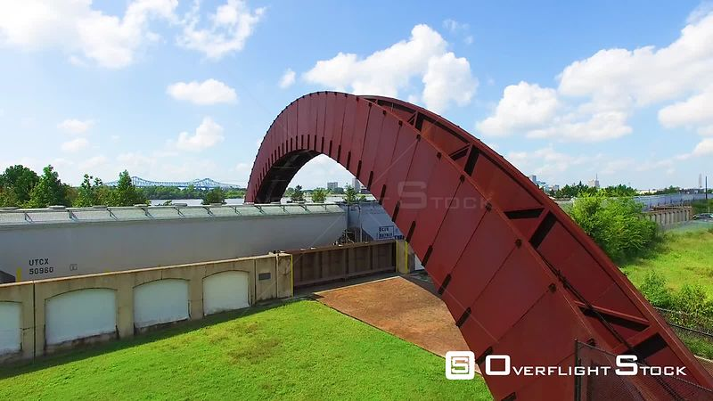 The bridge nicknamed the Rusty Rainbow in Crescent Park, overlooking the New Orleans, LA skyline and the Mississippi River
