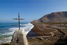 Rusted cross on headland above Bahia Camarones and River Camarones estuary, Region XV, Chile