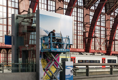 Teamwork on the job. Antwerp Central Station - Belgium.