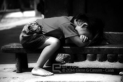 Young Hmong Girl Tired Outside Village House