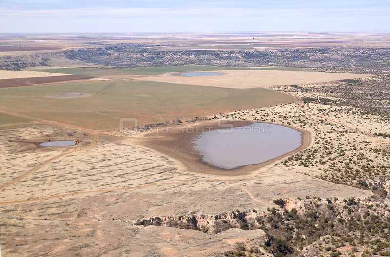 Aerial view of fields, temporary lake (playa) and arid plains, Llano Estacado, Texas, USA