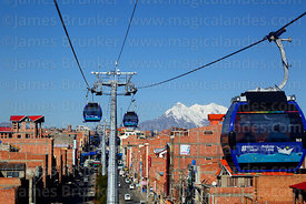 Blue Line cable car cabin with Mar para Bolivia / Sea for Bolivia slogan on it, Mt Illimani in background, El Alto, Bolivia