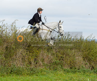 Dominic Gwyn-Jones jumping a hedge near Clawson Thorns