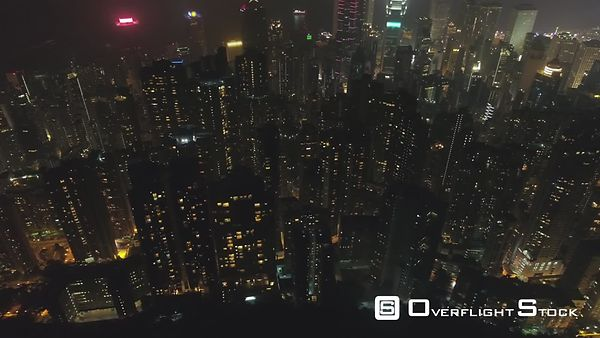 Hong Kong Residential Buildings at Night. Aerial Vertical TopDown View. Drone is Flying Sideways. Establishing Shot.