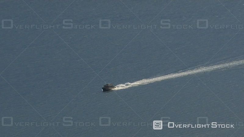 Aerial Footage of Boat in Alaska Strait. Zoom Out.