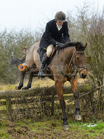 Charlie Smith jumping the hunt jump at Newbold - The Fitzwilliam Hunt visit the Cottesmore at Burrough House