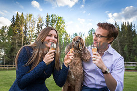 Happy Couple Feed Labradoodle Dog Ice Cream