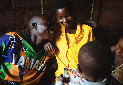 Rwanda - Kibileze - Jean Pierre Sibomana (31) who is HIV positive, talks with his wife and children who are HIV negative in K...