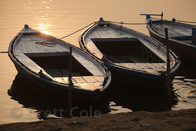 Boats at sunset on the Ganges River, Varanasi, India.
