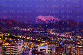 High rise buildings in Sopocachi at sunset and Mt Illimani, La Paz, Bolivia
