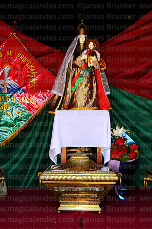Statue of Virgen del Carmen and caskets in honour of members of the Junta Tuitiva in shrine in San Francisco church during events to commemorate the uprising of July 16th 1809, La Paz, Bolivia